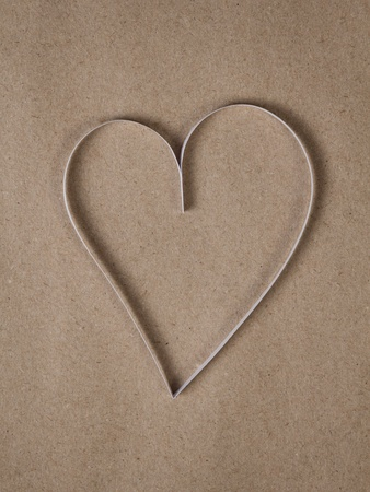 white paper heart on recycled paper, valentines background photo