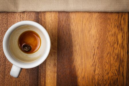 espresso cup on wood surface with space photo