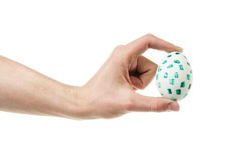 mam: adult mam hand holding egg, isolated on white Stock Photo