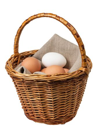 eggs in a basket, isolated on white photo