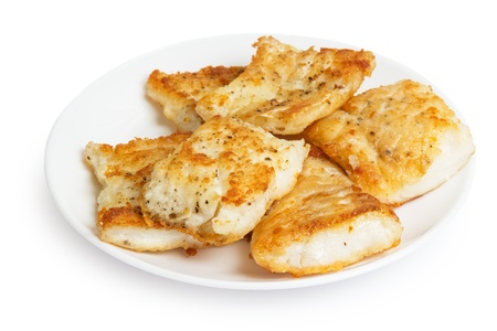 fried in flour codfish on plate, isolated on white background photo