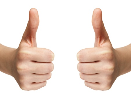 woman arms up: female teen hands shows thumbs up, isolated on white Stock Photo