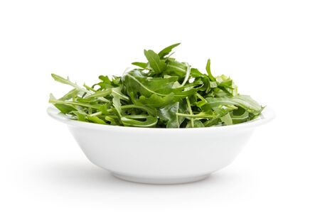 fresh rucola leaves in a bowl, isolated on white Stock Photo - 18167135