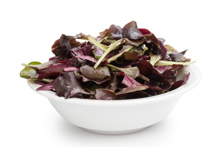purple spinach leaves in bowl, isolated on white photo