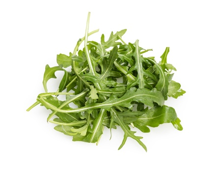 fresh rucola leaves, isolated on white photo