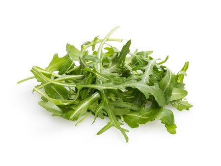 roquette: fresh rucola leaves, isolated on white