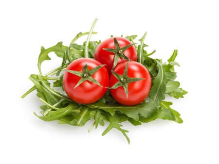 fresh rucola leaves with cherry tomatoes, isolated on white photo