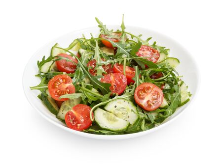 salad from ruccola, cherry tomatoes and cucumber, on white background photo