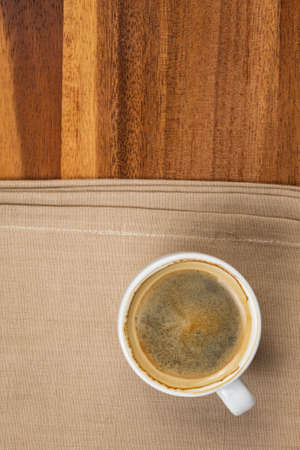 espresso in a cup on burlap surface photo