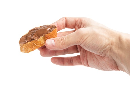 baguette slice spread with nut-choco paste in man hand, isolated on white Stock Photo - 18464201