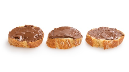 baguette slices spread with nut-choco paste, isolated on white