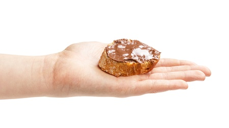 nit: baguette slice spread with nut-choco paste in female hand, isolated on white Stock Photo