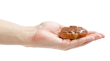 smeared hand: baguette slice spread with nut-choco paste, isolated on white