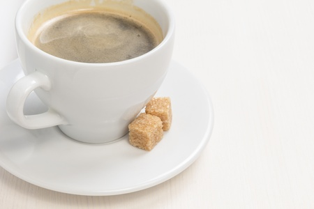 cup of espresso with cane sugar, on table photo