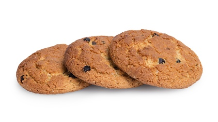 heap of oat cookies with raisins, isolated on white photo
