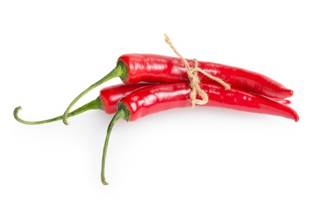 bunch of red chili peppers, isolated on white photo