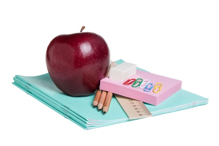 school supplies with apple, isolated on white photo