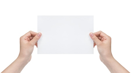two female teen hands holding blank paper sheet, isolated on white photo