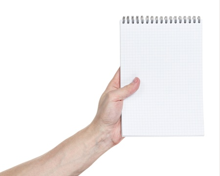 adult man hand holding notebook on a spring with blank page to write something, isolated photo