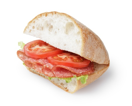 big sandwich with salami cheese and tomato, isolated on white photo