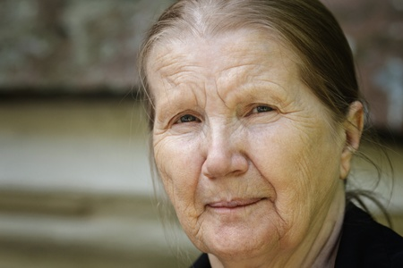portrait orientation: senior woman outdoor portrait, close horizontal orientation