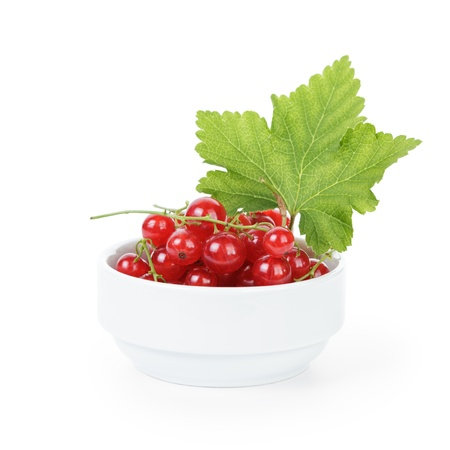 ribes: fresh ripe redcurrant with leaf in bowl, isolated on white