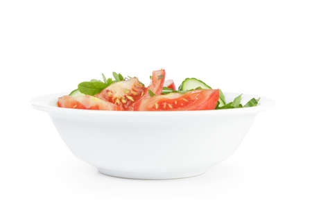 served plate with mix salad from tomatoes and cucumbers isolated on white photo