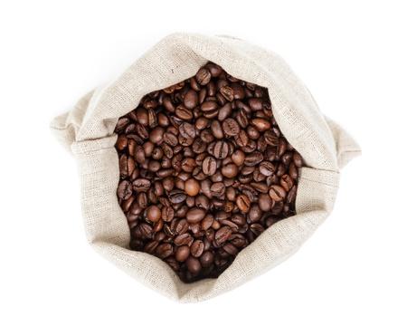 hessian bag: sack bag full of roated coffee beans, isolated on white