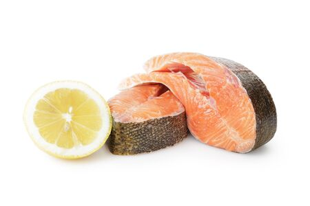 fresh trout steaks with lemon, on white background photo