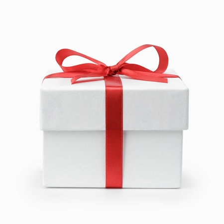 white textured gift box with ribbon bow, isolated on white
