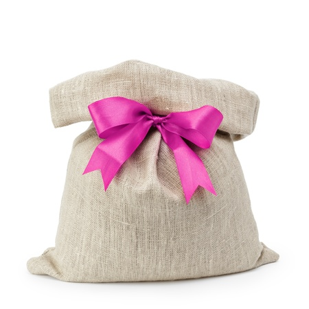 sack gift bag with ribbon bow, isolated on white photo