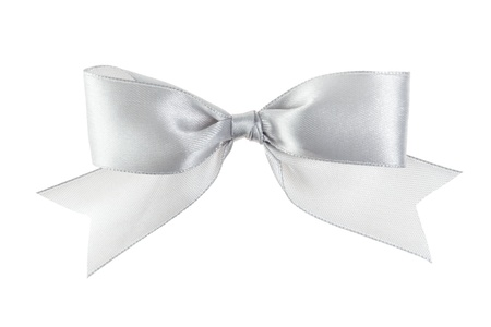 silver festive bow with tails made from ribbon, isolated on white