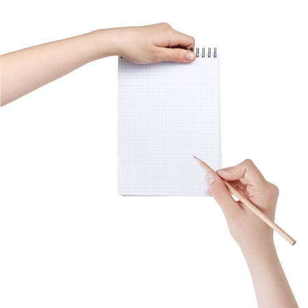 female teen hands writing something in notepad, isolated photo