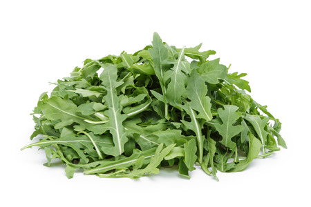 roquette: big heap of fresh arugula, isolated on white