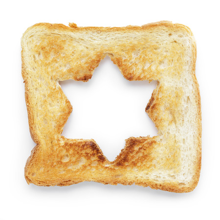 burnt out: toasted slice of white bread with hole star shape, on white with shadow Stock Photo