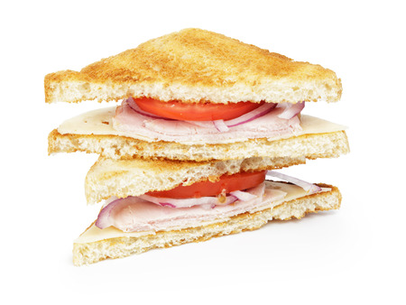 toasted sandwich: toasted sandwich for breakfast with ham, cheese and vegetables, white  Stock Photo
