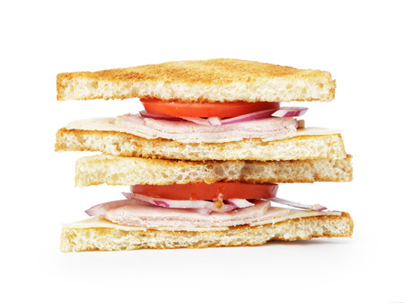 toasted sandwich for breakfast with ham, cheese and vegetables, white background photo