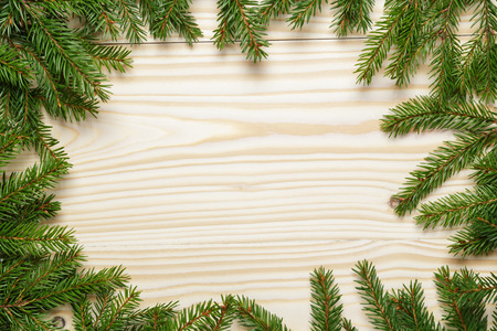 christmas from fir twigs on wooden table, horizontal photo