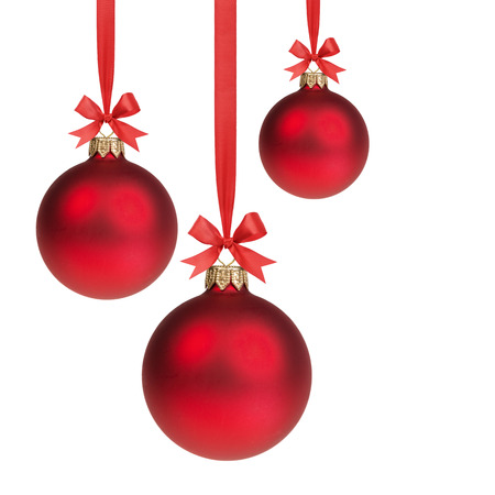 decor: three red christmas balls hanging on ribbon with bows, isolated on white