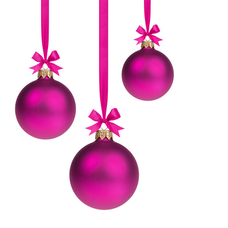magenta decor: composition from three purple christmas balls hanging on ribbon