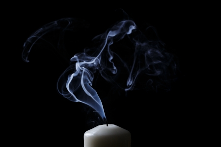 extinguished candle with blue smoke Imagens
