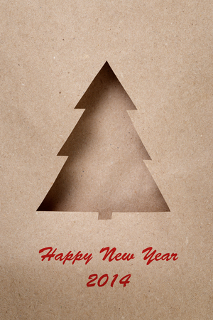 postcard with paper christmas tree, new year theme photo