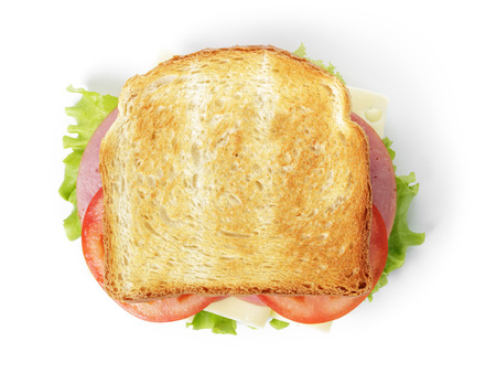toasted: sandwich with ham, cheese and vegetables, isolated