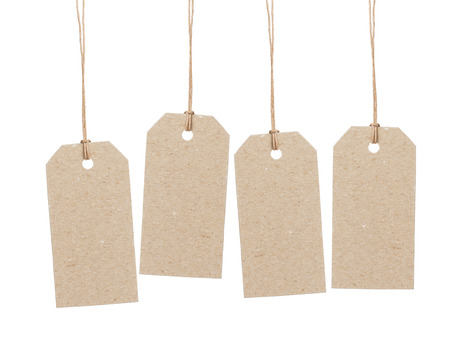 set of four empty tag on waxed cord with space for writing something, isolated on white background Standard-Bild