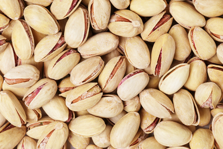 pista: roasted and salted pistachios, high detailed food background Stock Photo