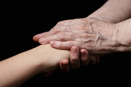 granddaughter and grandmother holding hands, support theme photo