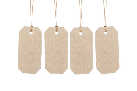 waxed: four brown tags hanging on ropes Stock Photo