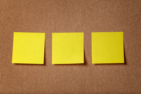 three reminder sticky notes on cork board, empty space for text photo