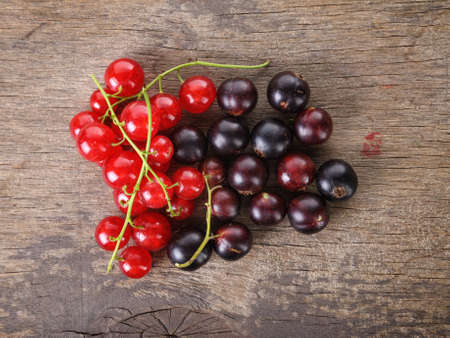 organic garden berries on old wood table, from above photo