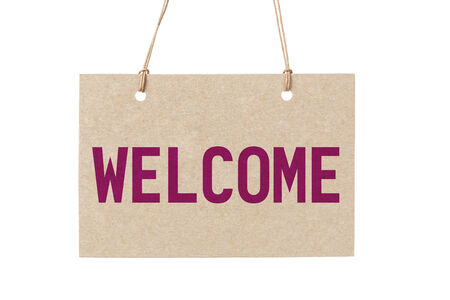 peg board: welcome sign from cardboard paper hanging on rope. isolated